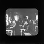 Boys working in machine shop