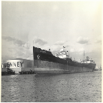 """[View of the ship """"Pan Massachusetts"""" in front of Jenney Manufacturing Company tank]"""
